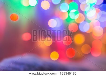 Christmas background with blurred colored lights.
