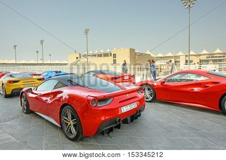 ABU DHABI, UAE - OCTOBER 08, 2016: Ferrari cars parked outside the Viceroy Hotel in Abu Dhabi which is known for its hosting of Formula One Grand Prix races
