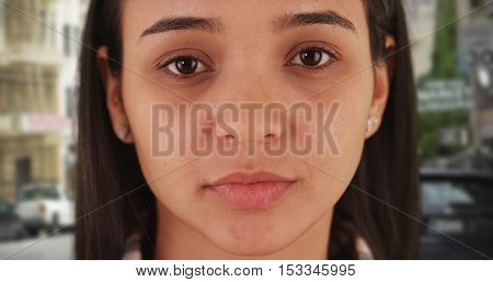 Portrait of Mexican woman looking at camera.