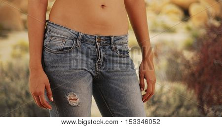 Closeup of Mexican woman wearing jeans outdoors
