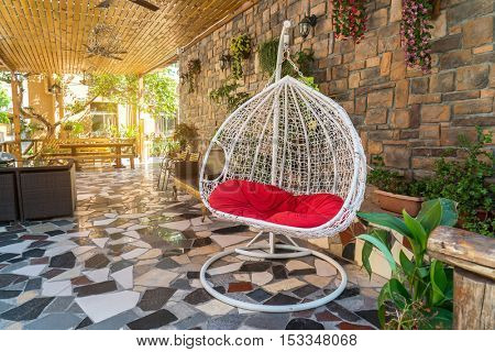 hanging chair with red seat