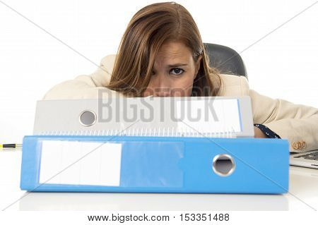 young attractive sad and desperate businesswoman suffering stress and headache at office desk looking worried depressed and overwhelmed with paperwork in overwork concept