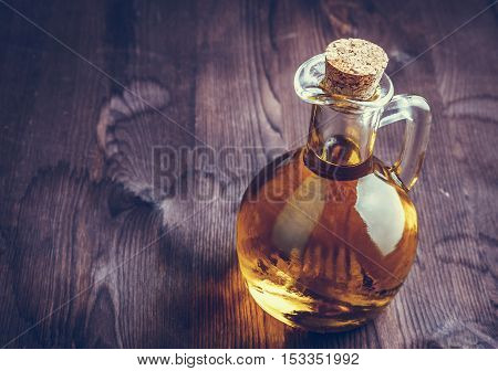 Olive Oil Container Bottle With Stopper On Wood Table Background, Warm Atmosphere