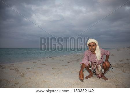 Socotra Yemen April 30th 2015: Yemeni man schewing khat on the beach