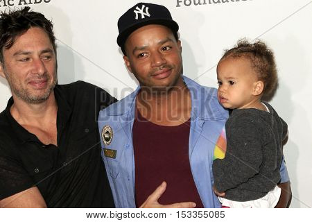 LOS ANGELES - OCT 23:  Zach Braff, Donald Faison, child at the Elizabeth Glaser Pediatric AIDS Foundation A Time For Heroes Event at Smashbox Studios on October 23, 2016 in Culver City, CA