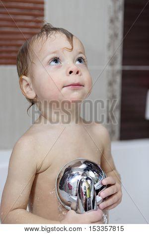 Pensive Kid At Bathroom
