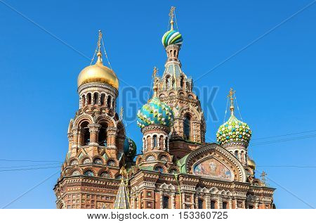 Domes of Church of the Savior on Spilled Blood against blue sky in St. Petersburg Russia