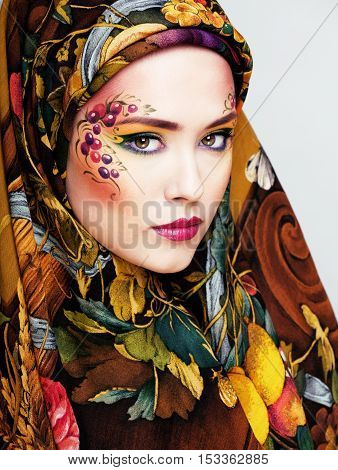 portrait of contemporary noblewoman with face art creative, halloween celebration look close up