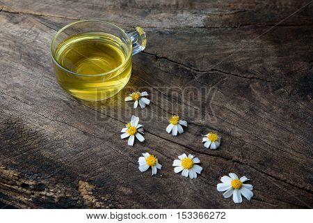 Chamomile Tea and Chamomile flower on old wooden table for background.
