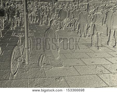 Beggar on street on golden metal basrelief
