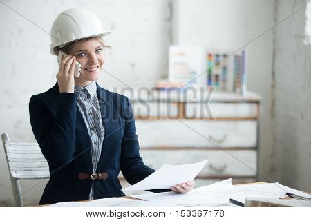 Young Woman Working In Architectural Agency