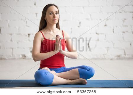 Young Female Practicing Yoga