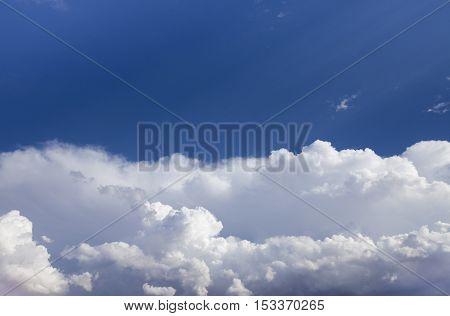 A blue split sky with cumulonimbus clouds
