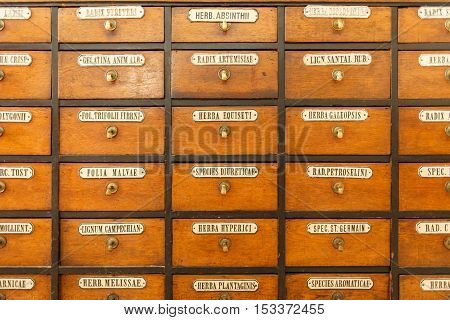 Old chest of drawers with herbal medicines in the pharmacy