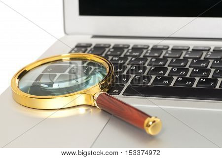 Laptop With Magnifying Glass on white background