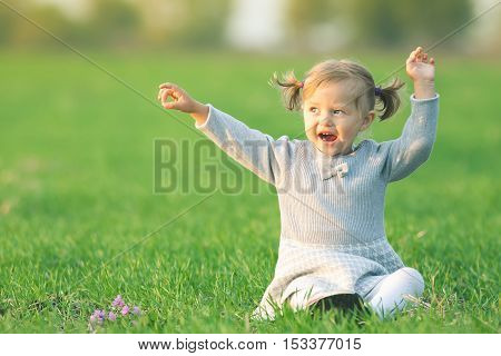 Endless summer. Happy child outdoor at yellow field raised his hands up. Autumn season. Happy Family Values. Girl. International Children's Day at 20 November or June 1 Universal Children's Day