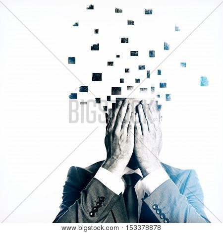 Businessman with broken into pieces head on light background. Overworked concept