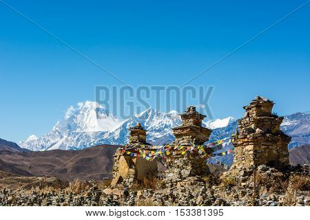 Buddhist chorten above Muktinath village, Dhaulagiri rising in the babkground. Mustang region in Nepal.