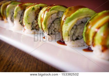 Eel avacado dragon roll with sushi bbq sauce