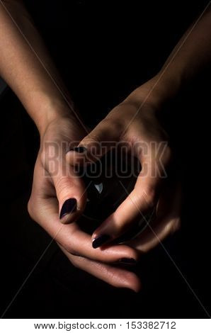 Female hands hold crystal ball for fortune telling background
