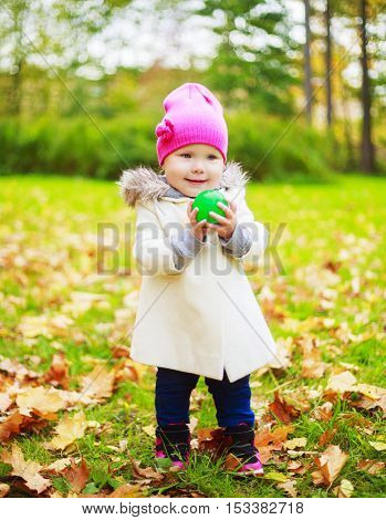 happy girl with a ball in the autumn park