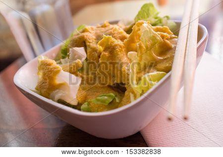 Miso ginger dressing Japanese house salad with iceberg lettuce
