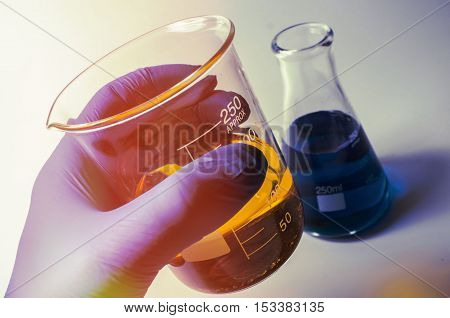 Close up glass measuring beaker for science experiment background