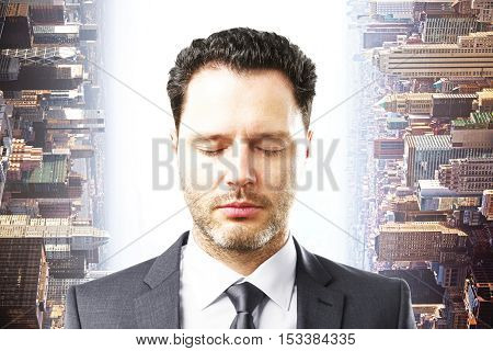 Portrait of handsome young businessman with closed eyes on abstract sideways city background