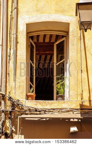 Open window of vintage appartment on hot weather in Aix-En-Provence South of France