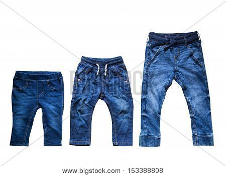 Kids grow up! Three pairs of jeans: My baby is growing. The concept of children grow up.