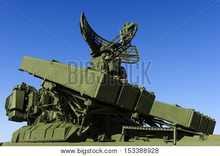 Missile launcher with six ballistic missiles ready to attack and radar on top of army transportation, antiaircraft forces, military industry, blue sky on background