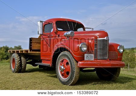 ROLLAG, MINNESOTA, Sept 1. 2016: An old  red one ton International restored truck is displayed at the annual WCSTR farm show in Rollag held each Labor Day weekend where 1000's attend annually