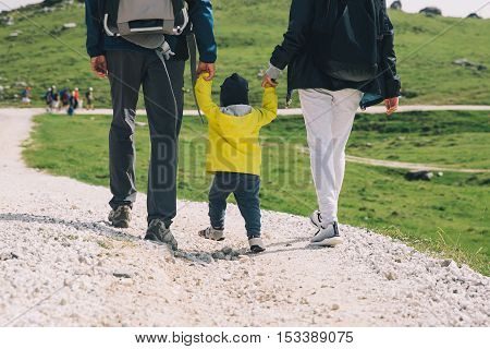 Family On A Trekking Day In The Mountains. Velika Planina Or Big Pasture Plateau, Slovenia.