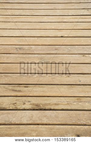 Close up of composite decking. Wood planks. Kiln dried wooden lumber texture background. Timber hardwood wall.