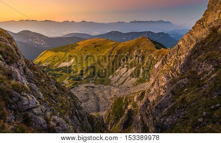 Mountain Landscape in Colorful Sunset. View from Mount Dumbier in Low Tatras Slovakia. West and High Tatras Mountains in Background.