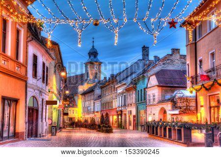 Beautiful romantic street illuminated in Christmas market, in Brasov, medieval town of Transylvania, Romania poster