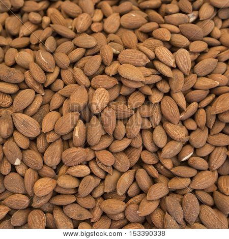 Almond. Almonds fon.Ochischenny almonds. Sale of almonds on the market. It can be used as background food (selective focus)
