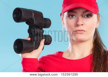Lifeguard in cap woman girl supervising with binoculars.