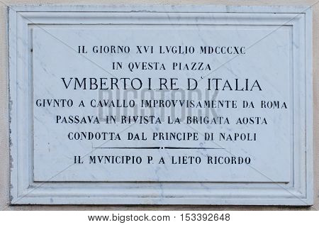 MANZIANA ITALY - OCTOBER 15 2016: Memorial plaque in Tommaso Tittoni Square remembering that here in 1880 Umberto I king of Italy was reviewing the Aosta Brigade conducted by the Prince of Naples.