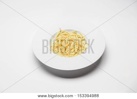 dish with spaghetti shot on white table