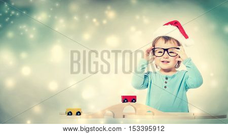 Toddler Girl With Santa Hat And Glasses