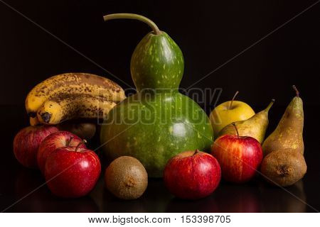 fruits on a dark background, studio picture