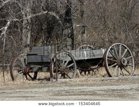 A abandoned horse drawn buck wagon with wooden wheels.