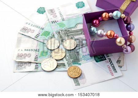 Box with a pearl bracelet and Russian money