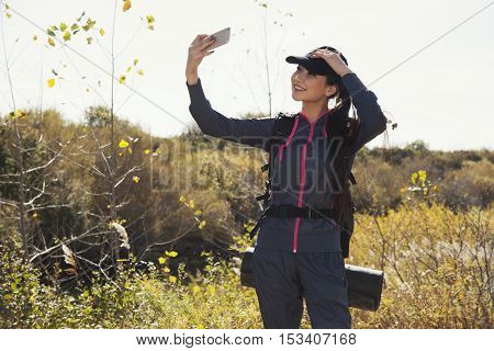 Torist Asian  Woman With Her Mobile Phone