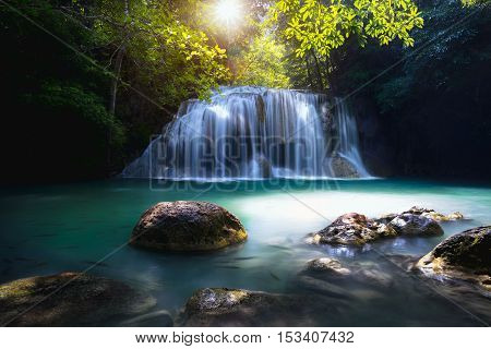 Beautiful waterfall with sunlight Nature landscape Useful for waterfall background Erawan waterfall Thailand
