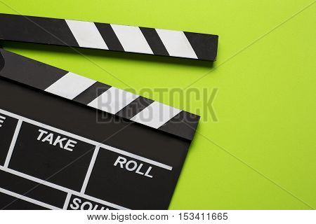 movie clapper on green background, top view
