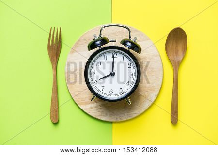 Meal time with alarm clock breakfast, food concept