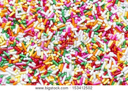 close up of colorful sprinkles jimmies for cake or ice cream topping