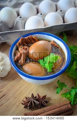 Eggs And Pork In Brown Sauce,thai Cuisine , Boiled Eggs With Chicken Drumstick In Sweet Gravy.eggs A